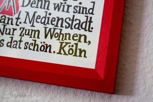 Holzrahmen um das Köln-Manifest