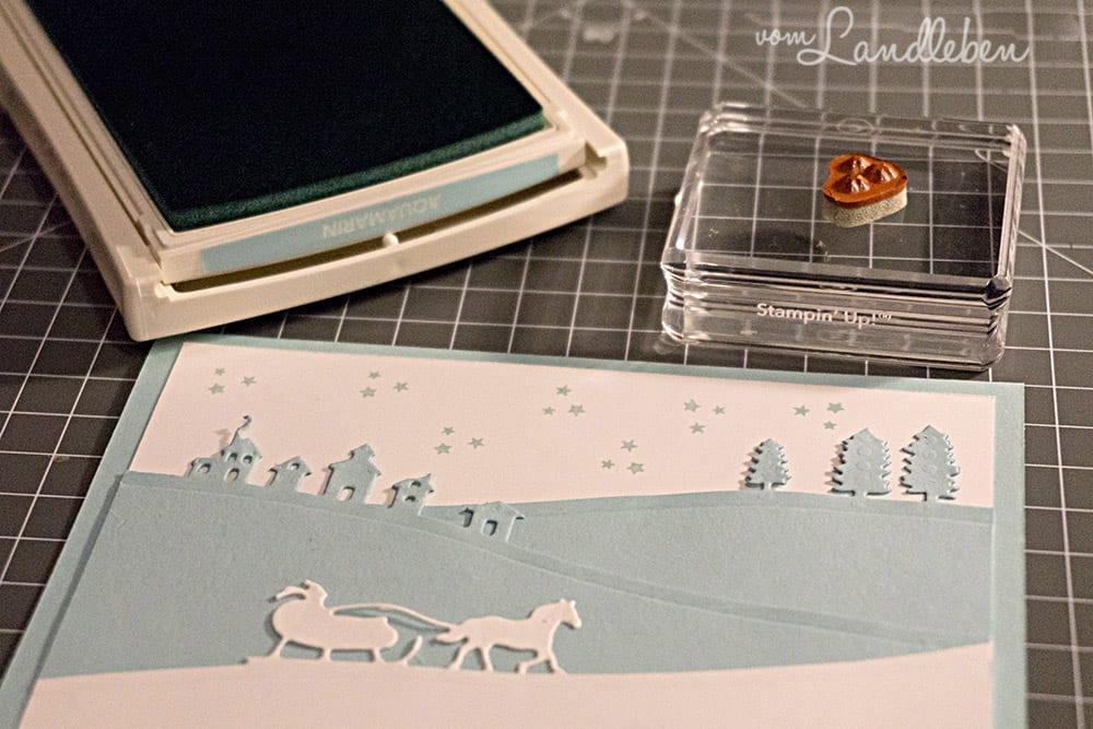Selbstgebastelte Weihnachtskarte mit Winterlandschaft