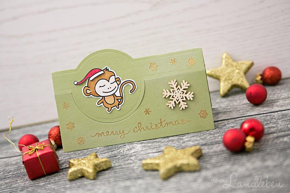 Selbstgebastelte Weihnachtskarte mit Affen