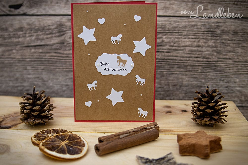 Selbstgebastelte Weihnachtskarte mit Pferden