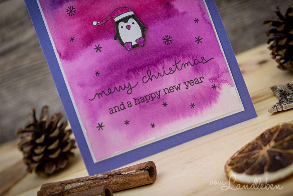 Selbstgebastelte Weihnachtskarte mit Pinguin